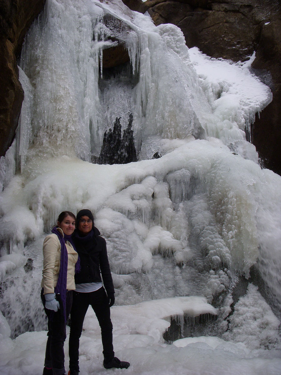 Merevin poses in front of Boulder Falls in Boulder, Colorado.