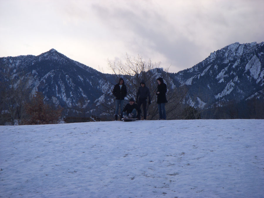 Merevin goes sledding with friends in Boulder, Colorado.