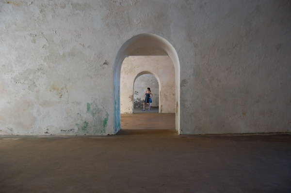 Meredith Lambert poses in the many archways of El Morro.