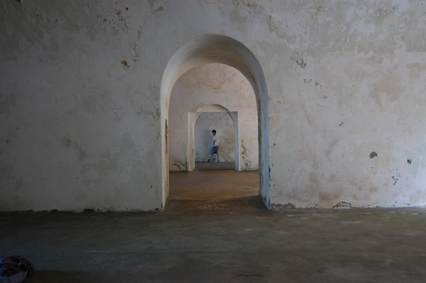 Kevin Banogon poses in the many arches of El Morro in Puerto Rico.