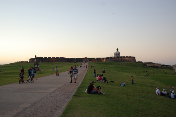 The public enjoys the lawn in front of El Morro's fortress.