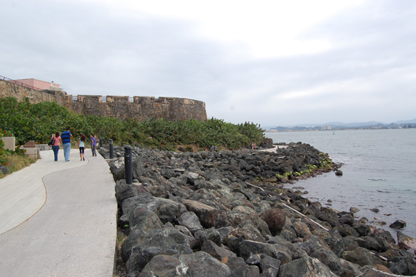 The public enjoys the walk along the water in San Juan.