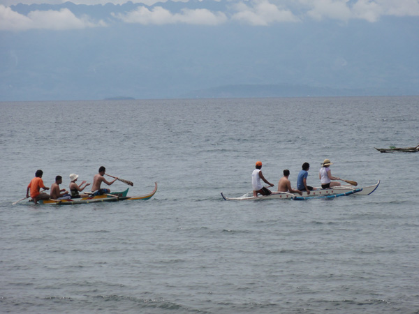 Meredith Lambert and Kevin Banogon canoe out from the shores of La Libertad during the reunion of the Banogon Clan.