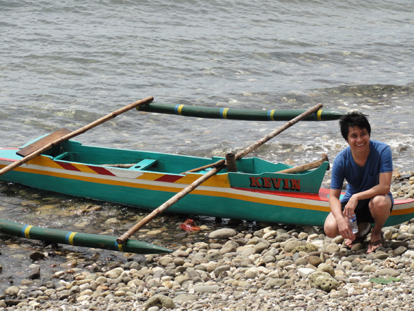 Kevin Banogon bonds with a canoe with the same name in the Philippines.