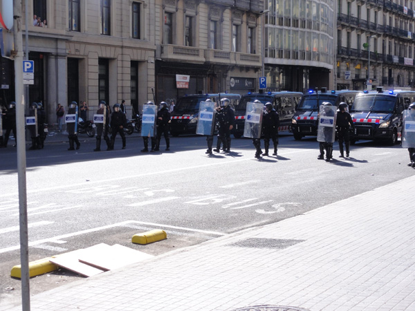 Riot police try to control a riot in Barcelona.