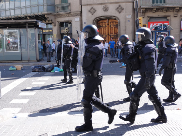 Riot police show up during a riot in Barcelona.