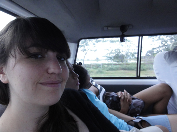 Meredith Lambert travels in a van to Dumaguete City.
