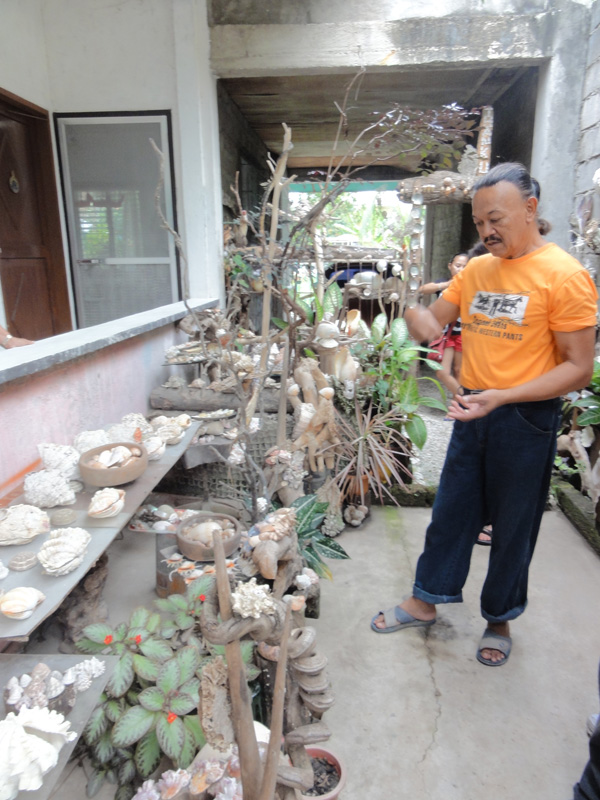 The curator of the Shell Garden outside of Dumaguete City.