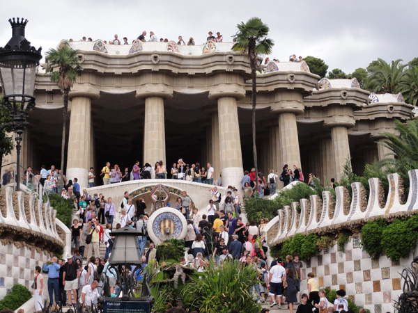 The entrance to Park Güell is constantly full of international travelers.