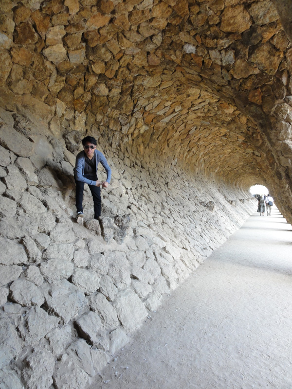 Kevin Banogon poses in the 'caves' of Park Güell made by the retaining walls.