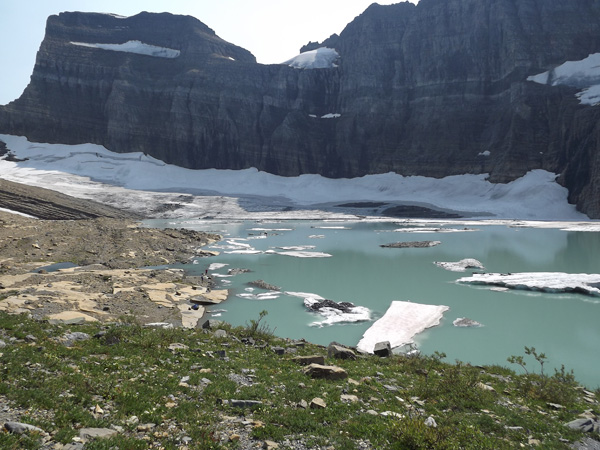 Grinnell Glacier in Glacier National Park and it's surrounding lake.