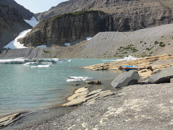 Kevin Banogon planks on a large boulder at Grinnell Glacier.
