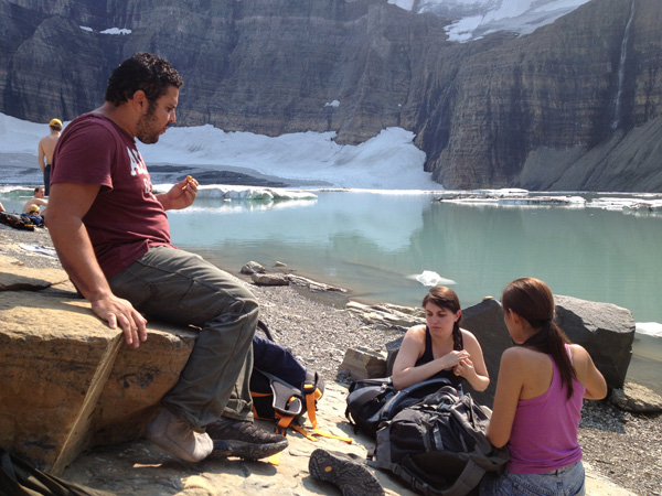 This group of hikers take a break at their destination at Grinnell Glacier in Glacier National Park.