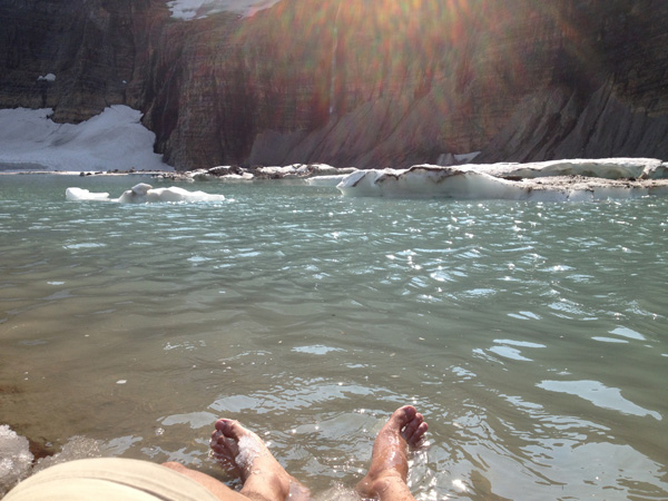 Kevin Banogon enjoys the icy water at Grinnell Glacier in Glacier National Park.