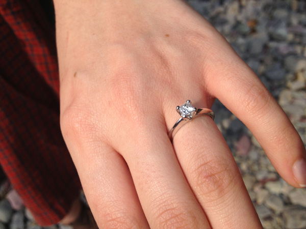 The engagement ring sparkled in the sun after the initial proposal.