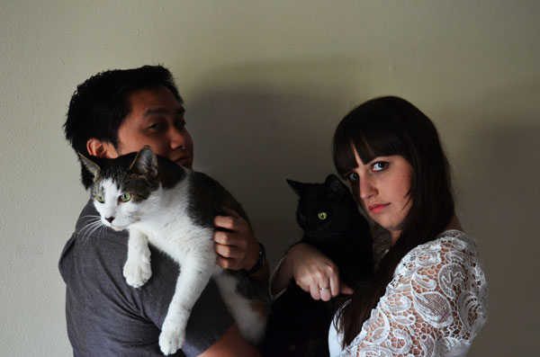 Engagement photos at home allow for the cats to be involved.