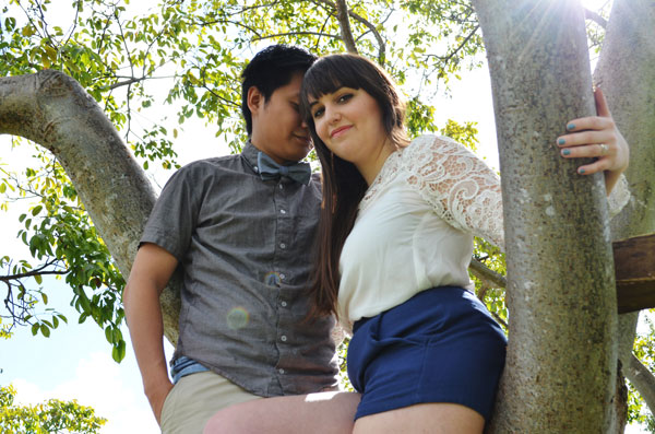 Merevin in a tree as they take engagement photos at home.