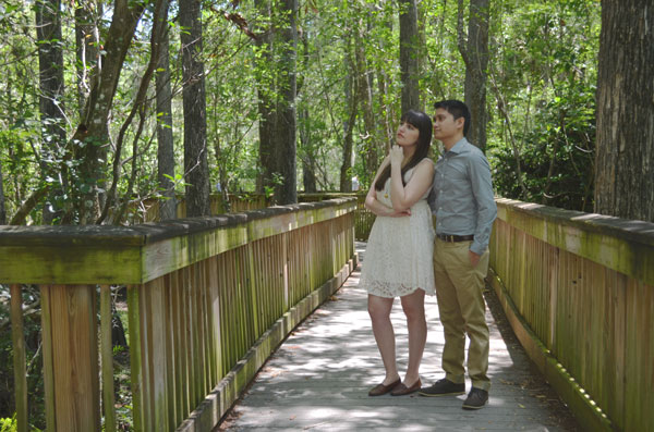 Meredith Lambert and Kevin Banogon ponder life's questions in their engagement photos in Big Cypress National Preserve.