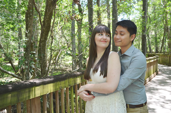 An awkward, but cute couple pose for engagement photos in Big Cypress National Preserve.