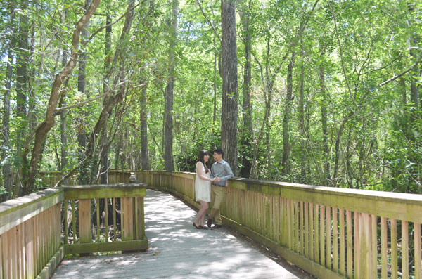 Miami travel bloggers, Kevin Banogon and Meredith Lambert relax in Big Cypress National Preserve as they take engagement photos.