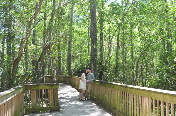 A couple shares an intimate moment among the cypress trees of Big Cypress National Preserve.