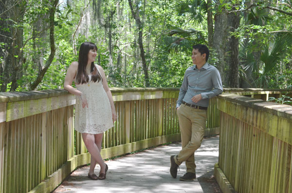 Kevin Banogon and Meredith Lambert share a moment while taking engagement photos in Big Cypress National Preserve.