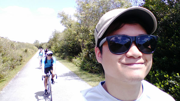 Kevin Banogon takes a selfie with the rest of the group behind him on Shark Valley in the Everglades.
