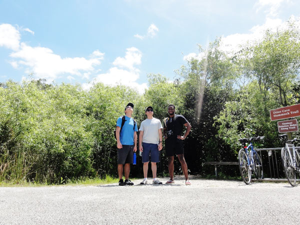 Three friends pose on a Miami travel blog as they bike Shark Valley.