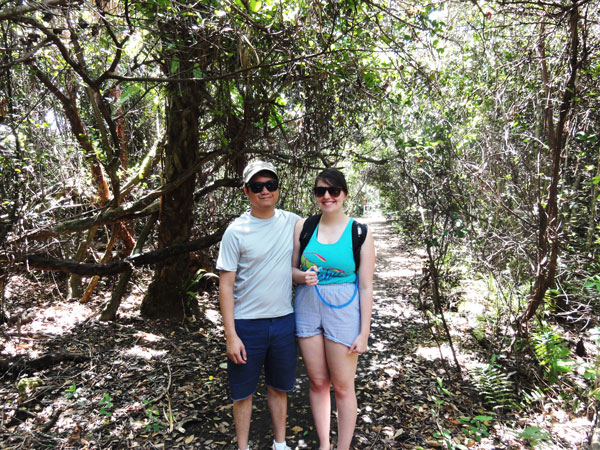 Meredith Lambert and Kevin Banogon pose for a picture along Shark Valley for their Miami travel blog.