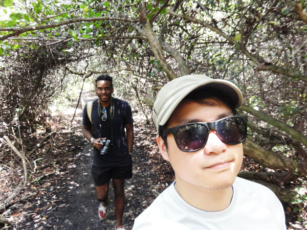 Miami travel blogger, Kevin Banogon takes a selfie while hiking at Shark Valley.