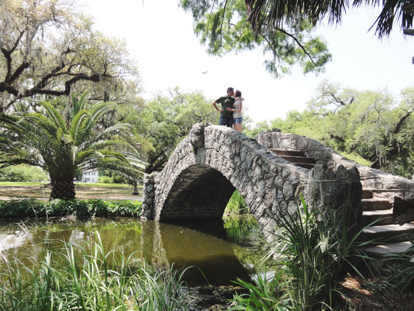 A young couple kisses on top the City Park's stone bridge in New Orleans, Louisiana.