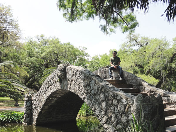 Colin Lambert relaxes on the stone bridge in City Park.
