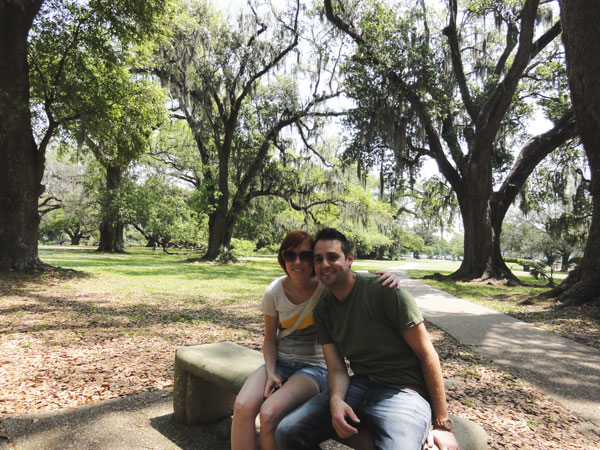 The Oak Alley at City Park is a peaceful resting spot for a young couple.