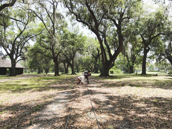 Meredith Lambert and Kevin Banogon embrace among the the Oak Alley at City Park in New Orleans, Louisiana.