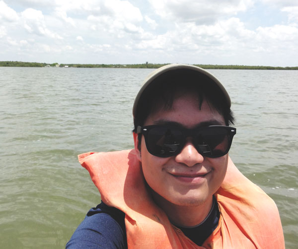 Kevin Banogon takes a selfie as he canoes through the Ten Thousand Islands.