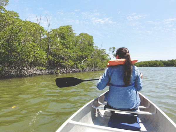 Meredith Lambert enjoys the views of the mangroves that make up the Ten Thousand Islands.