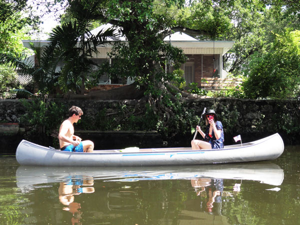 Matt and Steffy canoe through Little River in Miami's Little Haiti.