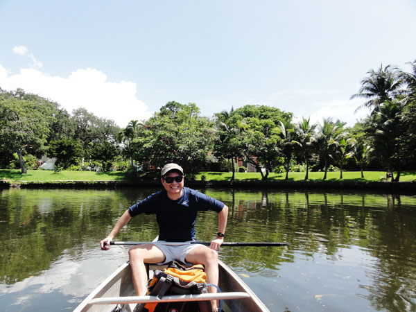 Kevin Banogon enjoys urban canoeing through Miami's Little River.