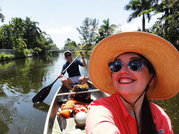 Miami travel bloggers, Meredith Lambert and Kevin Banogon, canoe through Miami's Little River.