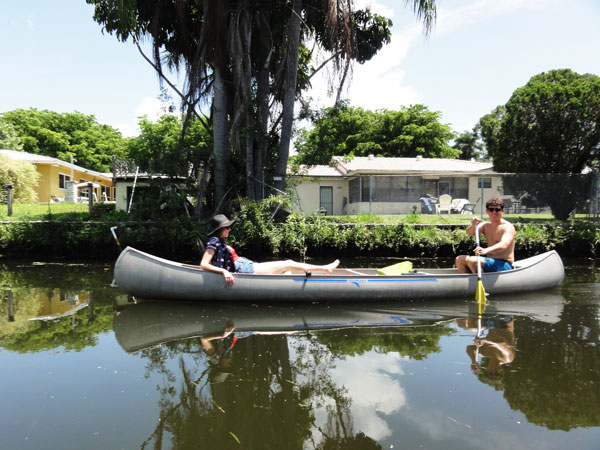 Matt and Steffy Degreff take it easy in the sun during their urban canoeing adventure.