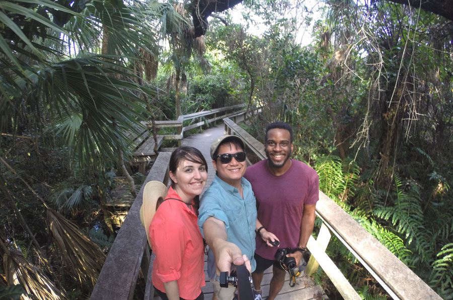 Meredith Lambert, Kevin Banogon, and Devin Thompson take a GoPro selfie along the trails in the Everglades.