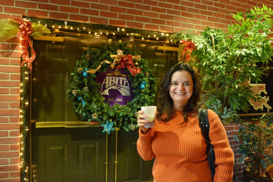 Charlene Kirstin waits for the Abita Brewery tour to start as she enjoys a beer she poured herself.