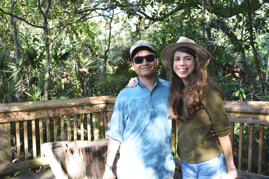 Kevin Banogon and Lauren Branzei pose for a picture along the boardwalk at Blue Springs State Park.