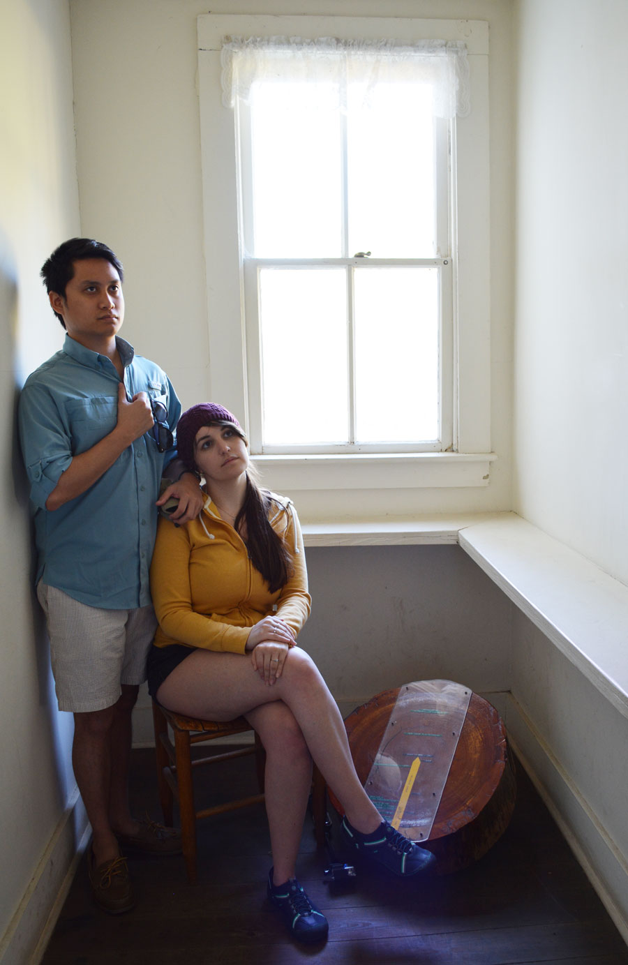 Meredith Lambert and Kevin Banogon in a small hallway in the Thursby House at Blue Springs.