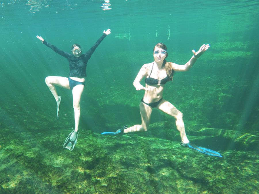 Meredith Lambert and Lauren Branzei do an underwater pose at Blue Springs State Park.