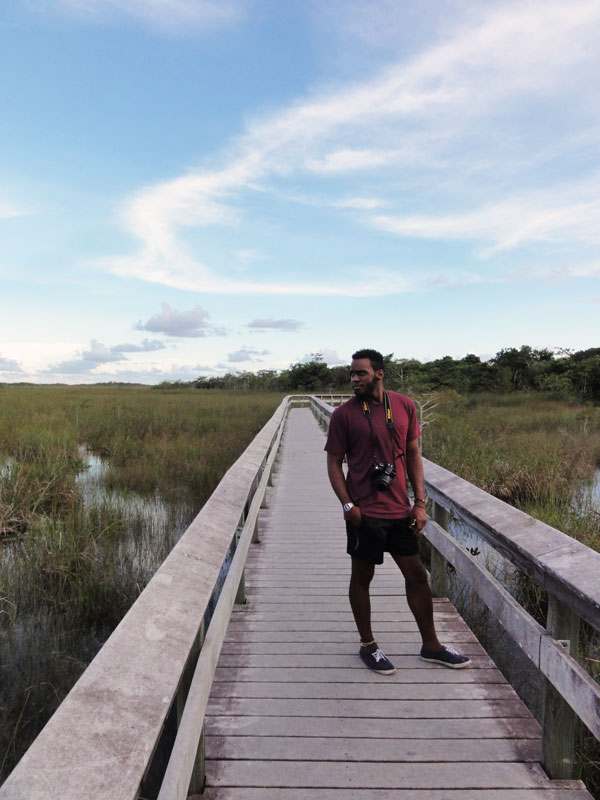 Devin Thompson strikes a pose along a trail in the Everglades.
