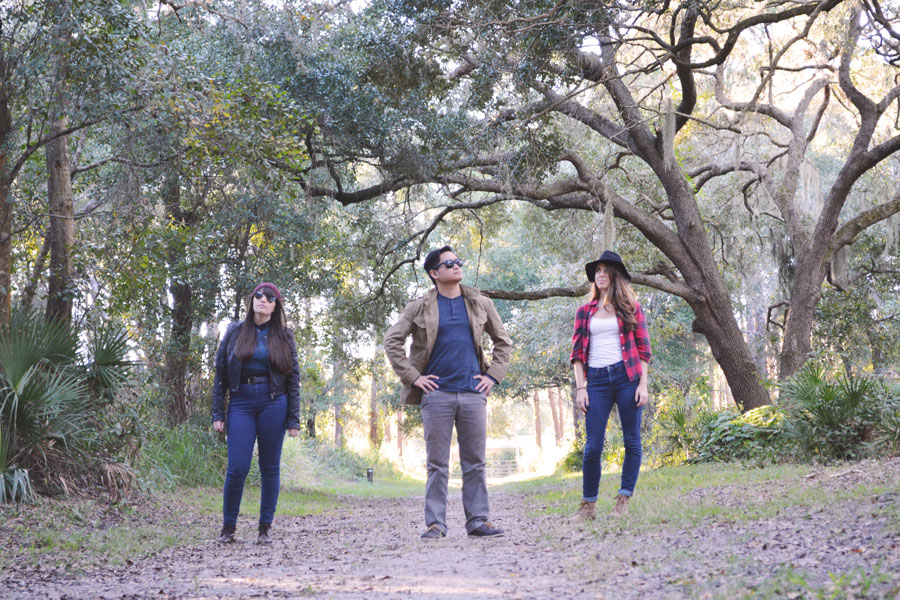 Kevin Banogon, Meredith Lambert, and Lauren Branzei take a band photo at the Red Bug Slough.