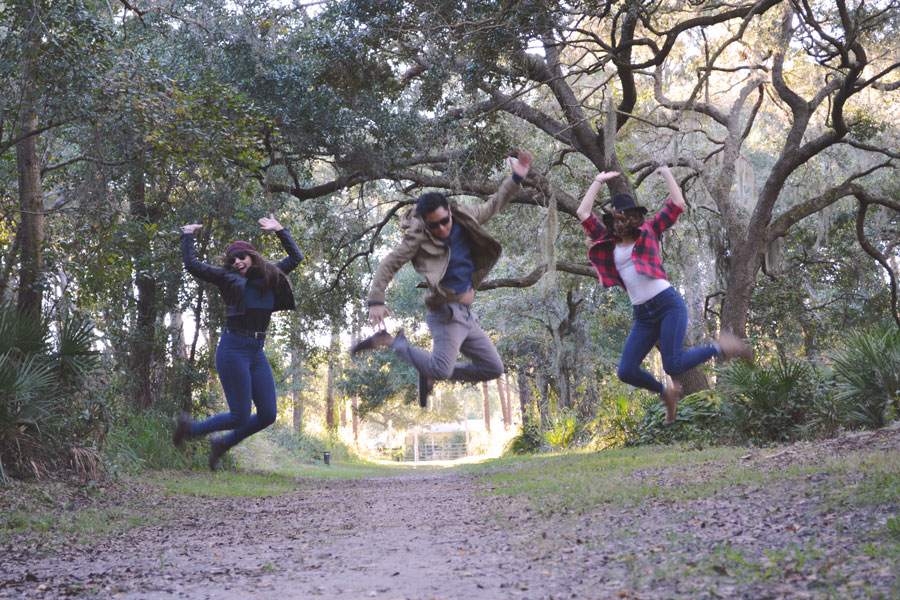 Kevin Banogon, Meredith Lambert, and Lauren Branzei jump for joy during their afternoon at the Red Bug Slough.