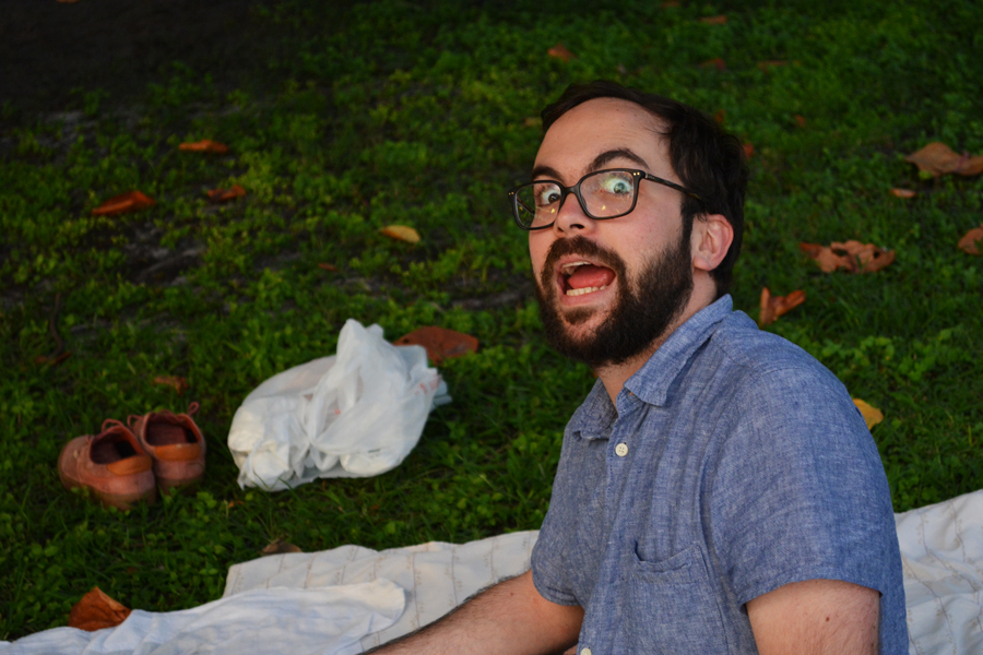 Alejandro Stein stops mid sentence during a picnic at South Pointe Park with friends.