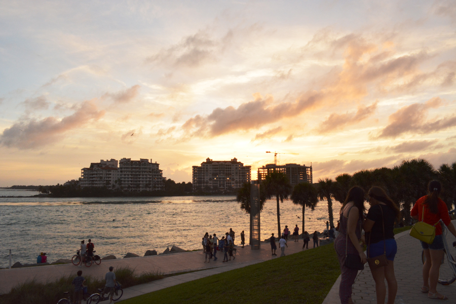 The sun sets and lights up the sky during sunset at South Pointe Park.